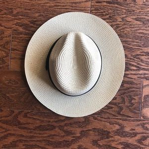 Tan stray hat with black band
